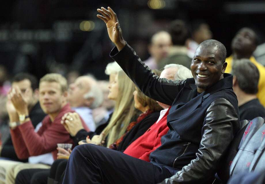 Hakeem Olajuwon acknowledges the crowd during a timeout. Photo: Eric Christian Smith, For The Chronicle