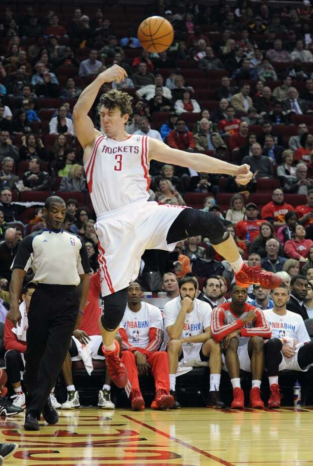 Houston center Omer Asik (3) prevents the ball from going out of bounds. Photo: Eric Christian Smith, For The Chronicle