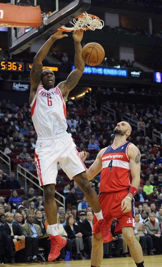 Houston forward Terrence Jones (6) slam dunks on an alley pop as Washington center Marcin Gortat looks on. Photo: Eric Christian Smith, For The Chronicle