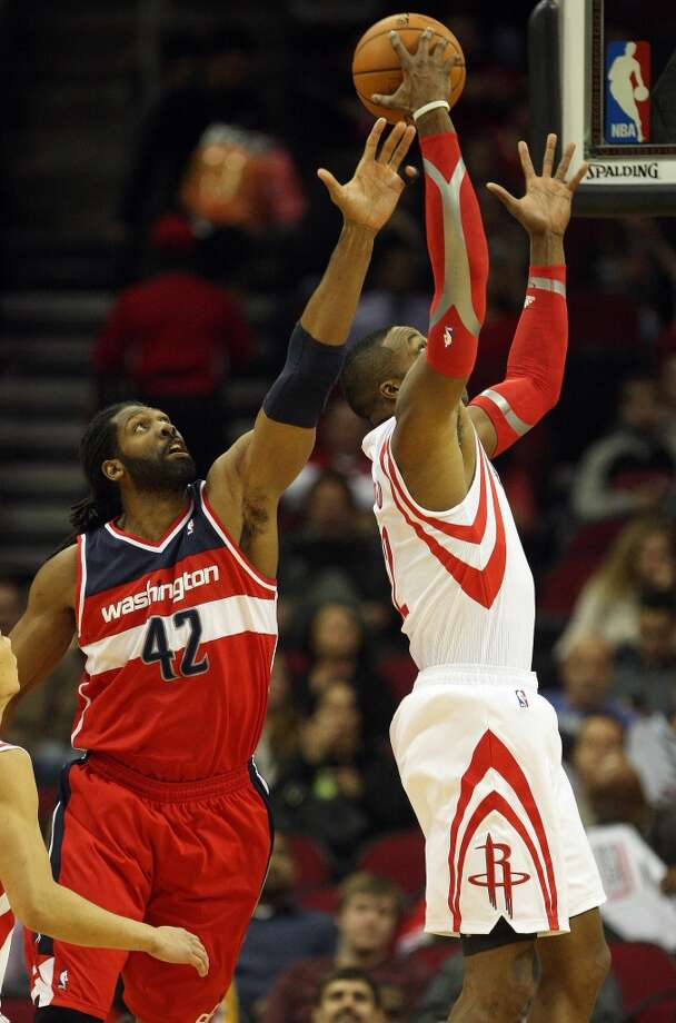 Dwight Howard, right, grabs a rebound over Nene. Photo: Eric Christian Smith, For The Chronicle