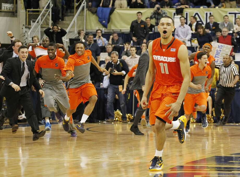 Freshman Tyler Ennis and the Syracuse bench erupt after Ennis hit a game-winning three-pointer. Photo: Charles LeClaire, Reuters