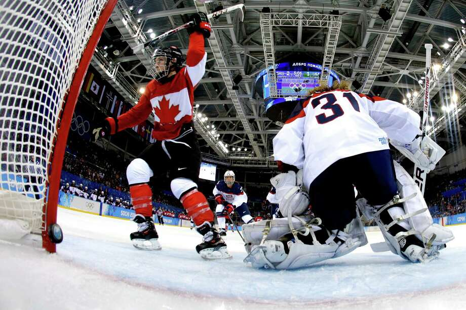 Meghan Agosta-Marciano #2 of Canada celebrates after scoring her second goal against Jessie Vetter #31 of the United States in the third period during the Women's Ice Hockey Preliminary Round Group A game on day five of the Sochi 2014 Winter Olympics at Shayba Arena on February 12, 2014 in Sochi, Russia.  (Photo by Matt Slocum - Pool/Getty Images) ORG XMIT: 461427075 Photo: Pool / 2014 Getty Images