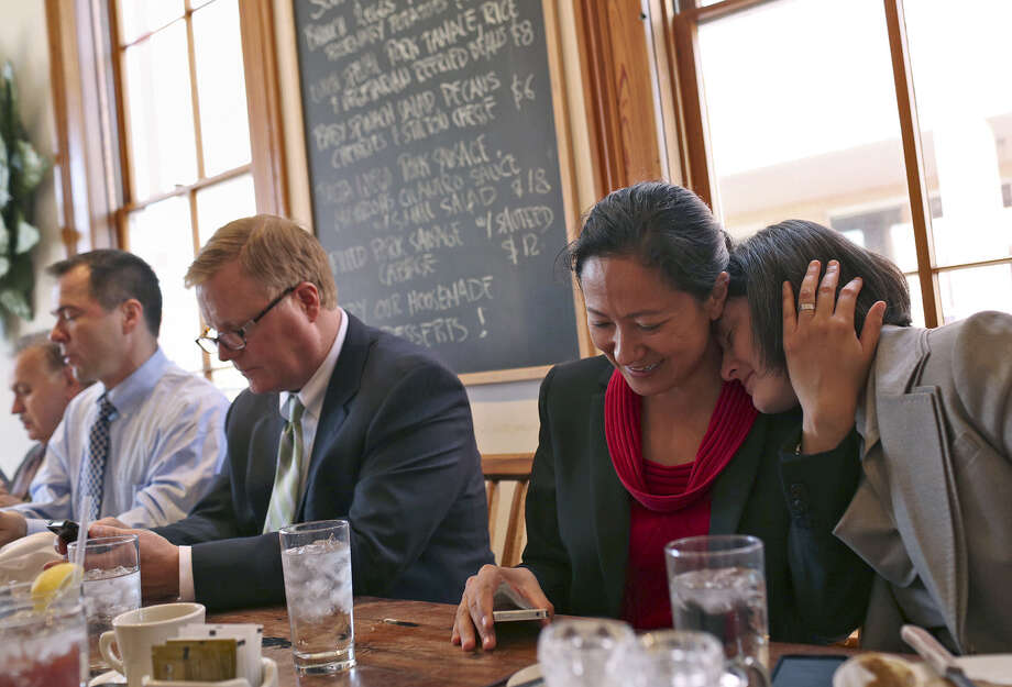 Nicole Dimetman (from right) relaxes with her wife, Cleo DeLeon, as they have lunch with fellow plaintiffs Mark Phariss and his partner, Victor Holmes, and their legal team at Liberty Bar after the hearing. Photo: Lisa Krantz / San Antonio Express-News / SAN ANTONIO EXPRESS-NEWS