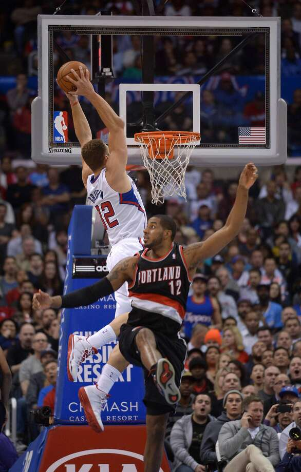 The Clippers' Blake Griffin dunks home two of his 36 points. Photo: Kirby Lee, Reuters