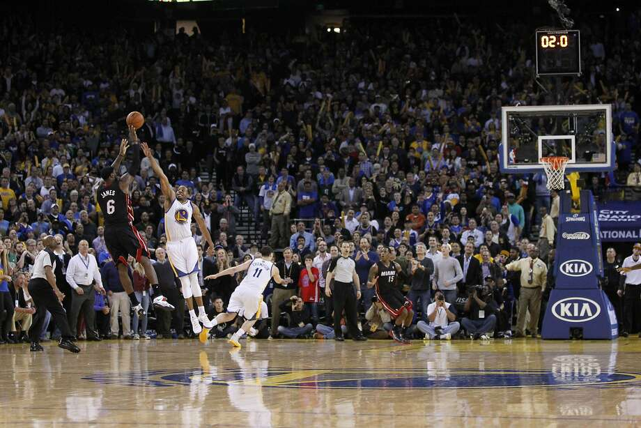 Miami's LeBron James, who scored a game-high 36 points, launches his winning three-pointer over the Warriors' Andre Iguodala. Photo: Cary Edmondson, Reuters