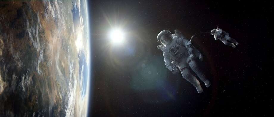 "Does stargazing reveal that ""Gravity"" will be the winner as best picture? Photo: Courtesy Of Warner Bros. Picture, Associated Press"