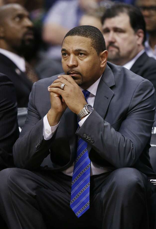 Golden State Warriors' Mark Jackson sits on the team bench in the closing moments during the second half of an NBA basketball game loss against the Phoenix Suns Saturday, Feb. 8, 2014, in Phoenix.  The Suns defeated the Warriors 122-109. (AP Photo/Ross D. Franklin) Photo: Ross D. Franklin, Associated Press