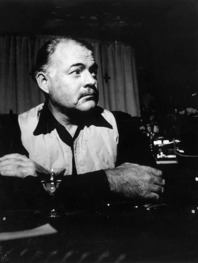 Writer Ernest Hemingway (1899-1961), in a familiar pose. Photo: Hulton Archive, Getty Images