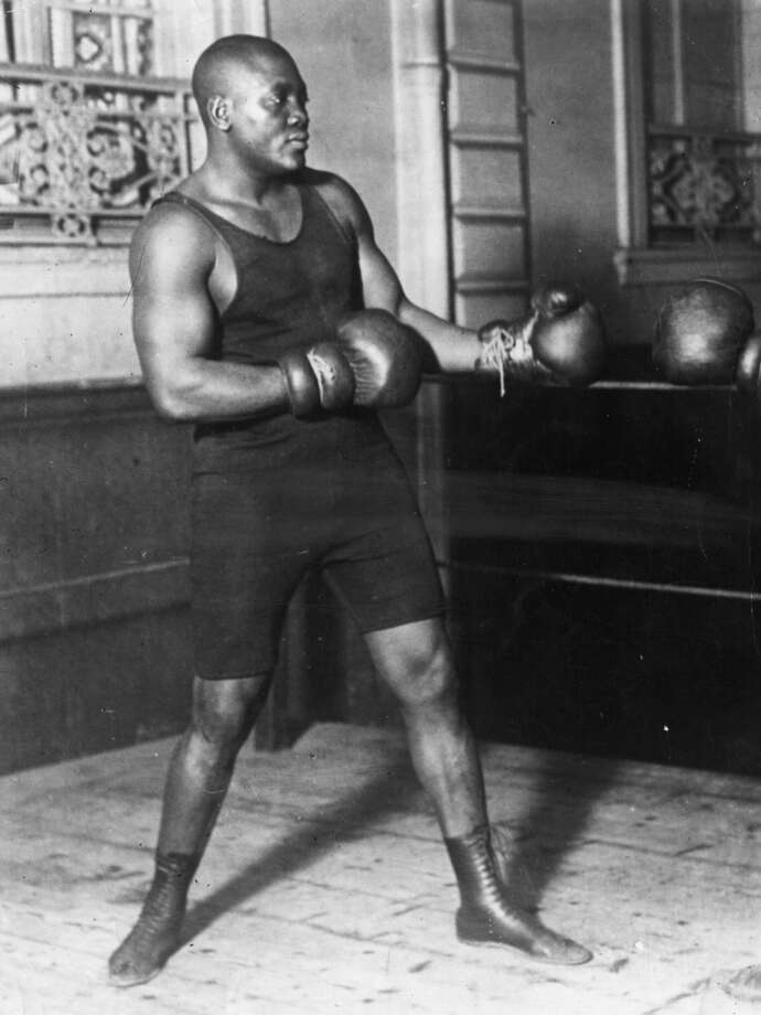 American heavyweight boxer Jack Johnson in action sparring.  (Photo by Topical Press Agency/Getty Images) Photo: Topical Press Agency, Getty Images