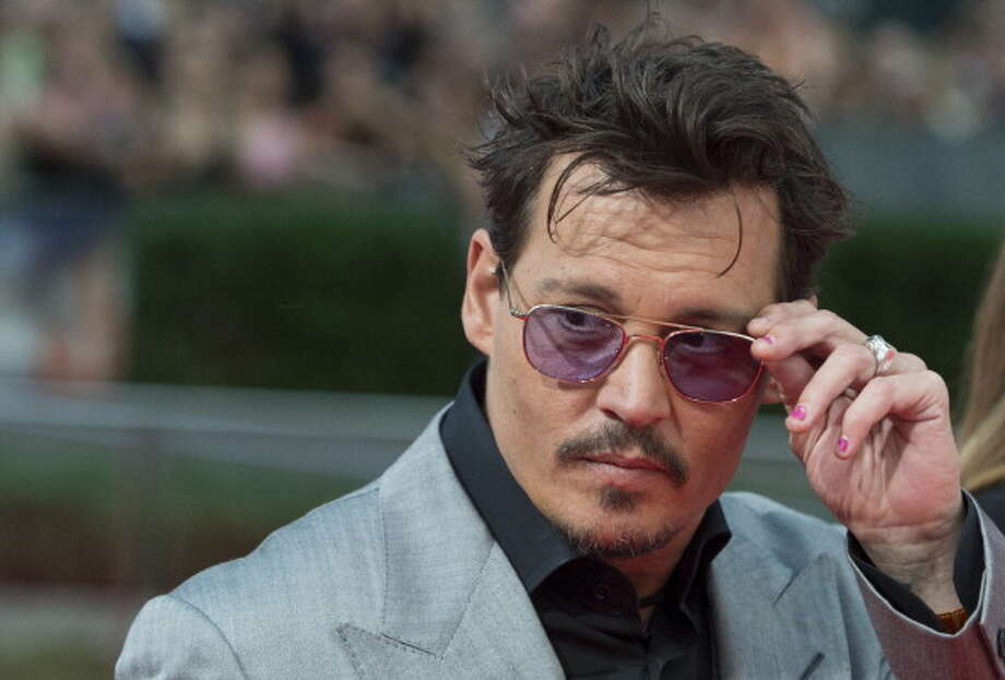 "US actor Johnny Depp arrives for the premiere of the film ""The Lone Ranger"" on July 19, 2013 in Berlin. The film will start in German cinemas on August 8, 2013. AFP PHOTO / JOHANNES EISELE        (Photo credit should read JOHANNES EISELE/AFP/Getty Images) Photo: JOHANNES EISELE, AFP/Getty Images / 2013 AFP"