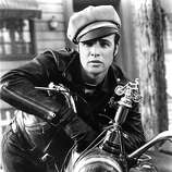 "1953: Actor Marlon Brando rides a Triumph motorcycle in a scene from the movie ""The Wild One"" which came out in 1953. (Photo by Michael Ochs Archives/Getty Images)"