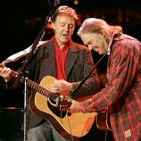 Neil Young, with a famous friend, perform at the annual Bridge Concert at Shoreline Amphitheater. Photo by Kim Komenich in Mountain View.