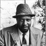 Thelonius Monk enjoying his champagne cocktail, San Francisco.    Ran on: 11-26-2005 Thelonius Monk, top left, enjoys a champagne cocktail. He was part of the vibrant jazz scene that saw Cal Tjader, top, on his boat in Sausalito, drumming on coffee cans. Summing it all up, the city and the sound, is Darnell Howard, bottom, posing on Lombard Street.