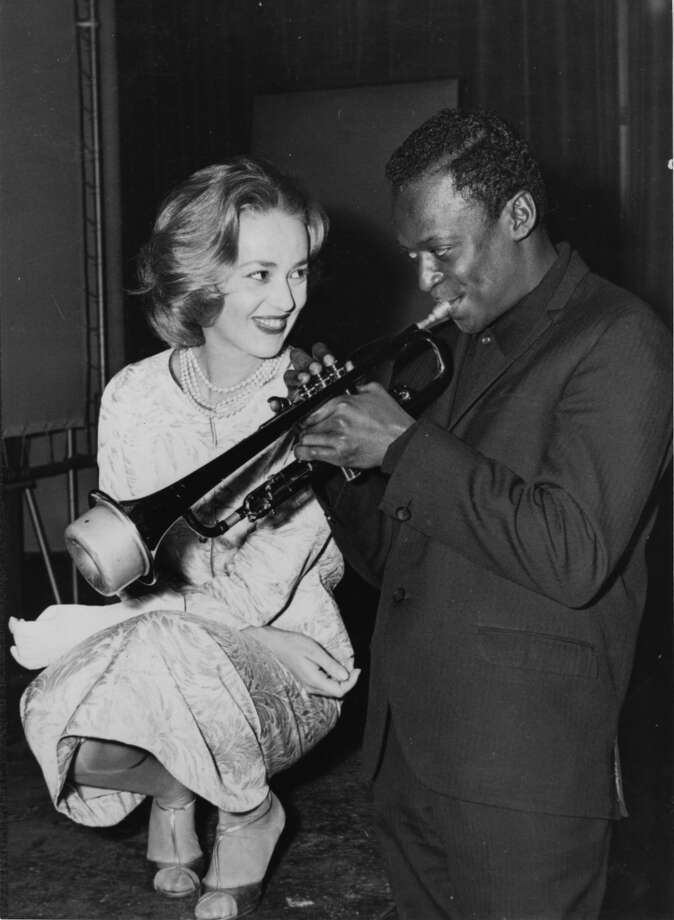 Jazz musician Miles Davis (1926 - 1991) playing his horn, with French actress Jeanne Moreau watching admiringly.    (Photo by Keystone/Getty Images) Photo: Keystone, Getty Images