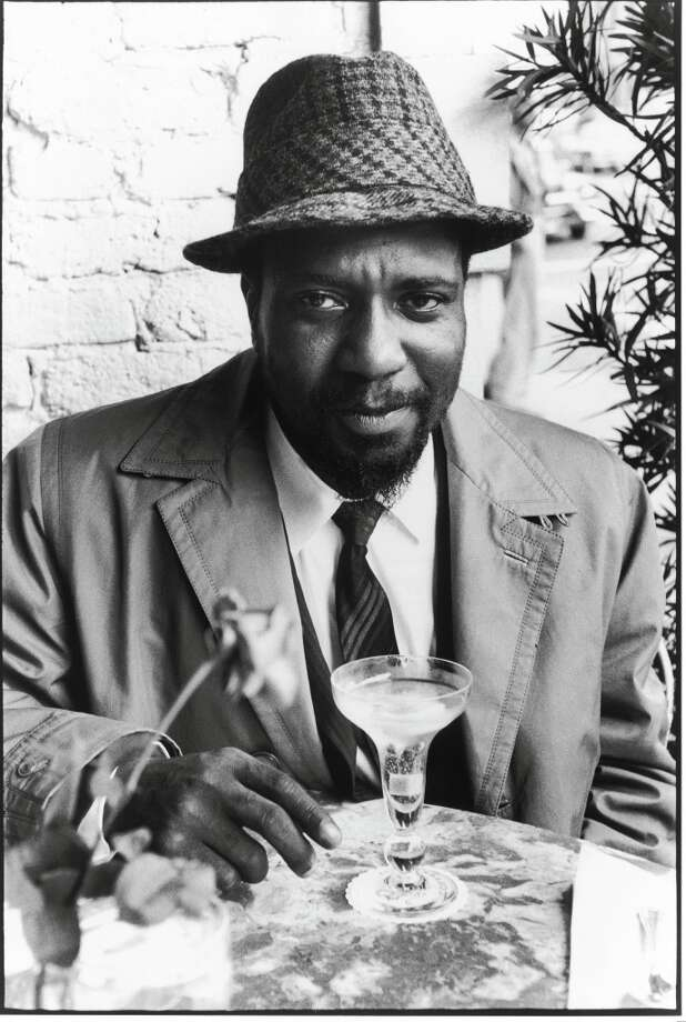 Thelonius Monk enjoying his champagne cocktail, San Francisco.    Ran on: 11-26-2005 Thelonius Monk, top left, enjoys a champagne cocktail. He was part of the vibrant jazz scene that saw Cal Tjader, top, on his boat in Sausalito, drumming on coffee cans. Summing it all up, the city and the sound, is Darnell Howard, bottom, posing on Lombard Street. Photo: William Claxton