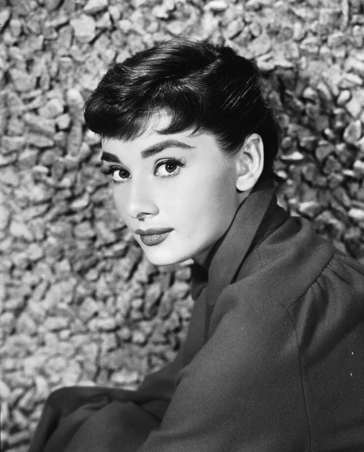 Portrait of Belgian-born American actress Audrey Hepburn (1929 - 1993) as she sits by a stone wall, early 1950s. (Photo by Hulton Archive/Getty Images) Photo: Hulton Archive, Getty Images