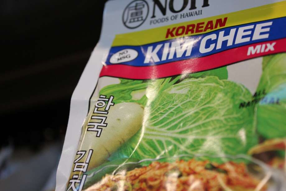 You can make your own kimchi from scratch, use a seasoning packet like this, or buy it already prepared (see the final slide).  From there, I think these recipes look yummy:   kimchi omelet and fried rice with kimchi and greens.