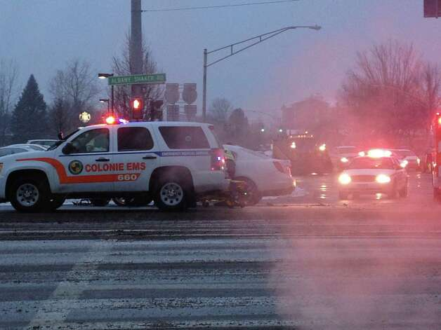 As the snow started to fall Thursday, police and firefighters responded to a car crash at the interesection of Albany Shaker Road and Wolf Road in Colonie. (Mike Goodwin / Times Union)