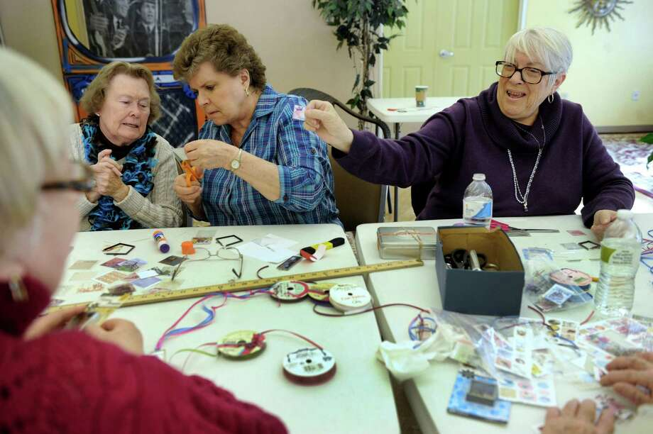 "Chris Sleight, 82, Arlene Bennett and Grace Scalera, 72, are part of a crafts class Wednesday, Feb. 12, 2014,  at the New Fairfield Senior Center in New Fairfield, Conn. This day they are working on ""Easy Peasy"" pendants. Photo: Carol Kaliff / The News-Times"