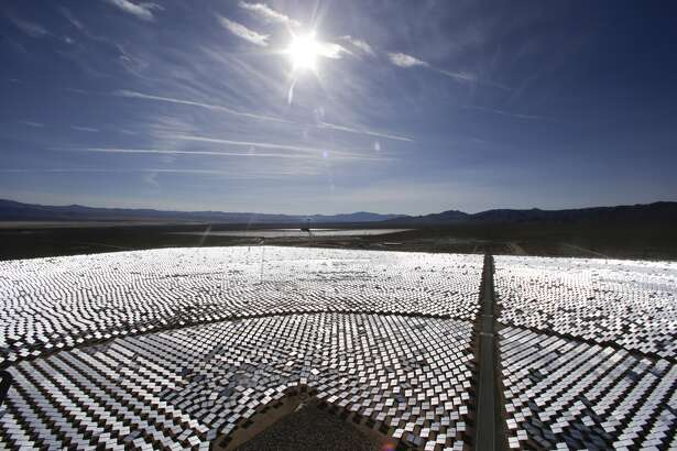 Some of the 300,000 computer-controlled mirrors, each about 7 feet high and 10 feet wide, reflect sunlight to boilers that sit on 459-foot towers. The sun's power is used to heat water in the boilers' tubes and make steam, which in turn drives turbines to create electricity in Primm, Nev. The Ivanpah Solar Electric Generating System, sprawling across roughly 5 square miles of federal land near the California-Nevada border, opened in 2014 after years of regulatory and legal tangles.