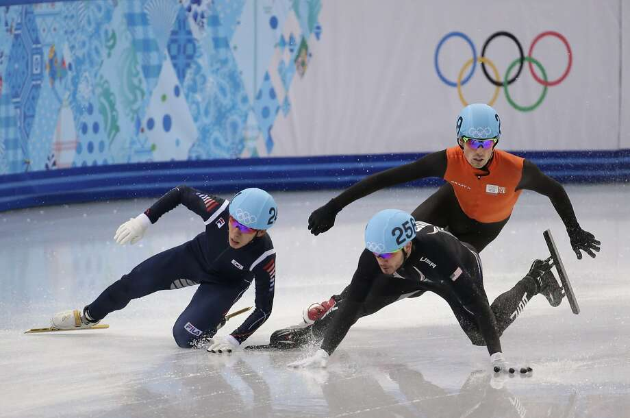 Lee Ho-suk of South Korea, left, and Eduardo Alvarez of the United States crash out alongside Freek Van Der Wart of the Netherlands as they compete in a men's 5000m short track speedskating relay semifinal at the Iceberg Skating Palace during the 2014 Winter Olympics, Thursday, Feb. 13, 2014, in Sochi, Russia. Photo: Bernat Armangue, Associated Press