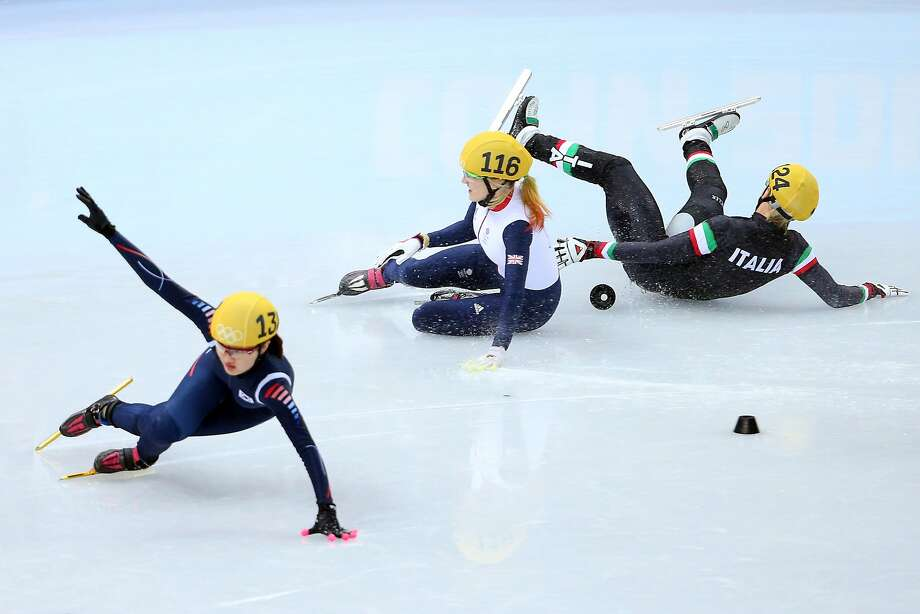 Elise Christie of Great Britain (C) falls and collides with Seung-Hi Park of South Korea (L) and Arianna Fontana of Italy (R) as she competes in the Short Track Speed Skating Ladies' 500 m Final on day 6 of the Sochi 2014 Winter Olympics at at Iceberg Skating Palace on February 13, 2014 in Sochi, Russia. Photo: Quinn Rooney, Getty Images