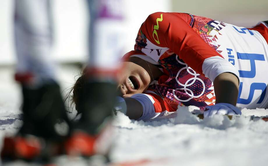 Canada's Brittany Webster lies on the snow after completing the women's 10K classical-style cross-country race, at the 2014 Winter Olympics, Thursday, Feb. 13, 2014, in Krasnaya Polyana, Russia. Photo: Gregorio Borgia, Associated Press