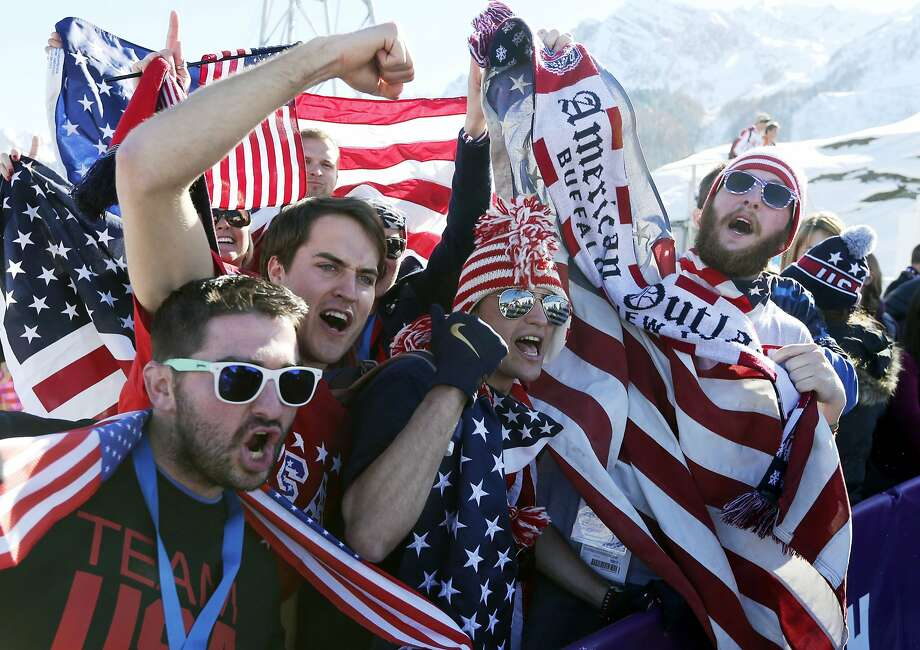 U.S. supporters pose for photos after U.S. skiers swept all three medals in the men's ski slopestyle final at the Rosa Khutor Extreme Park, at the 2014 Winter Olympics, Thursday, Feb. 13, 2014, in Krasnaya Polyana, Russia. Photo: Sergei Grits, Associated Press