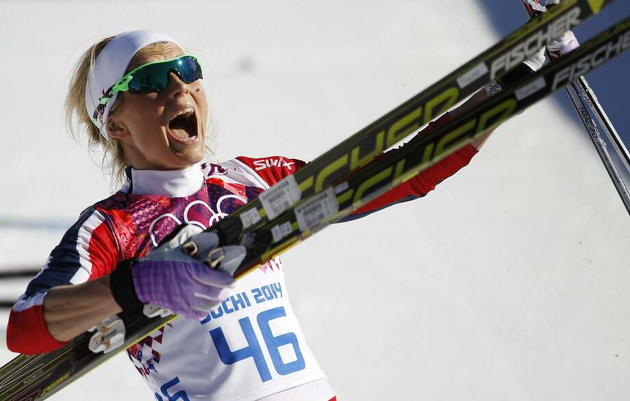 Norway's Therese Johaug celebrates winning the bronze during the women's 10K classical style cross-country race at the 2014 Winter Olympics, Thursday, Feb. 13, 2014, in Krasnaya Polyana, Russia.  Photo: Matthias Schrader, Associated Press
