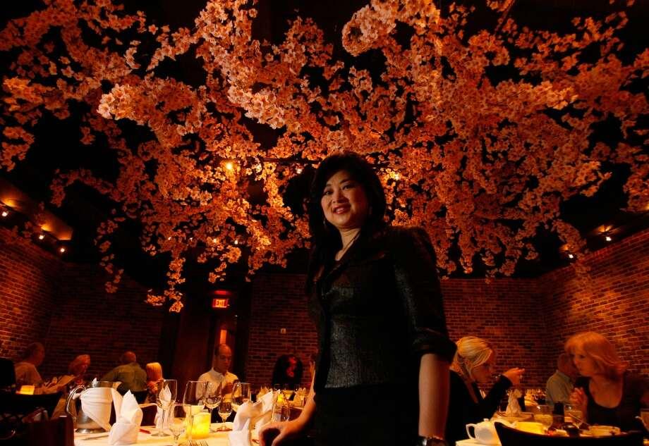 Gigi Huang poses in her new Galleria restaurant Gigi's Asian Bistro and Dumpling Bar on Thursday, June 12, 2008, in Houston. It is redefining the Galleria dining scene. (Photo: Sharon Steinmann / Chronicle ) Photo: Sharon Steinmann, Houston Chronicle