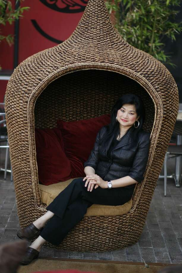 Gigi Huang poses on the outdoor patio in her new Galleria restaurant Gigi's Asian Bistro and Dumpling Bar on Thursday, June 12, 2008, in Houston.  (Photo: Sharon Steinmann / Chronicle ) Photo: Sharon Steinmann, Houston Chronicle