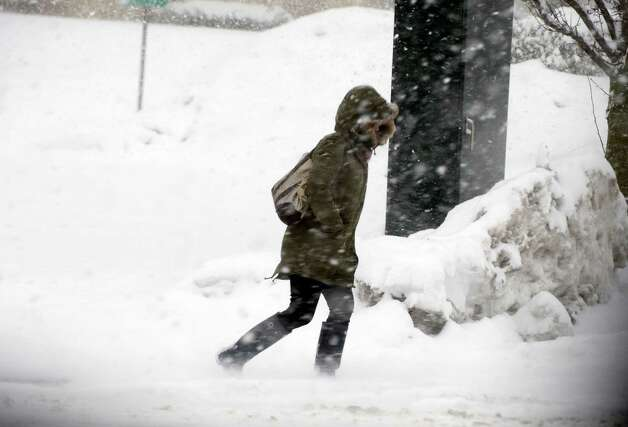 A pedestrian walks through the snow in Greenwich, Conn., on Thursday, February 13, 2014. Photo: Lindsay Perry / Stamford Advocate