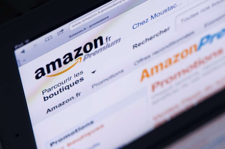 Amazon ranked 25th in the  25 highest rated companies compiled by Glassdoor. Out of a perfect 5, Amazon scored 3.9. (Lionel Bonaventure/AFP/Getty Images) Photo: LIONEL BONAVENTURE, AFP/Getty Images