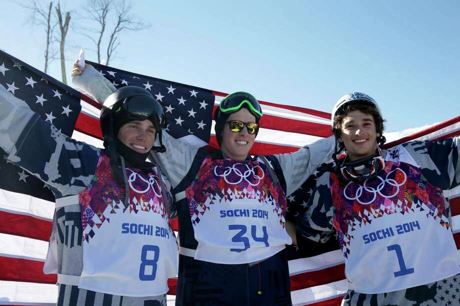 The new Olympic slopestyle skiing event was swept by US competitors, who became the first Olympic medalists in the sport. Gus Kenworthy, left, silver, Joss Christensen, center, gold, and Nicholas Goepper, bronze, right, celebrate after their win. Photo: Gero Breloer, Associated Press / AP
