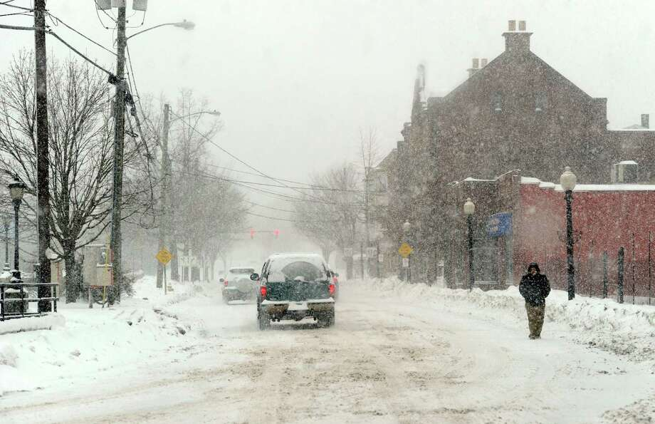 Traffic is light on Crosby Street in Danbury, Conn. during the early stages of a snow storm Thursday, morning, Feb. 13, 2014. Photo: Carol Kaliff / The News-Times