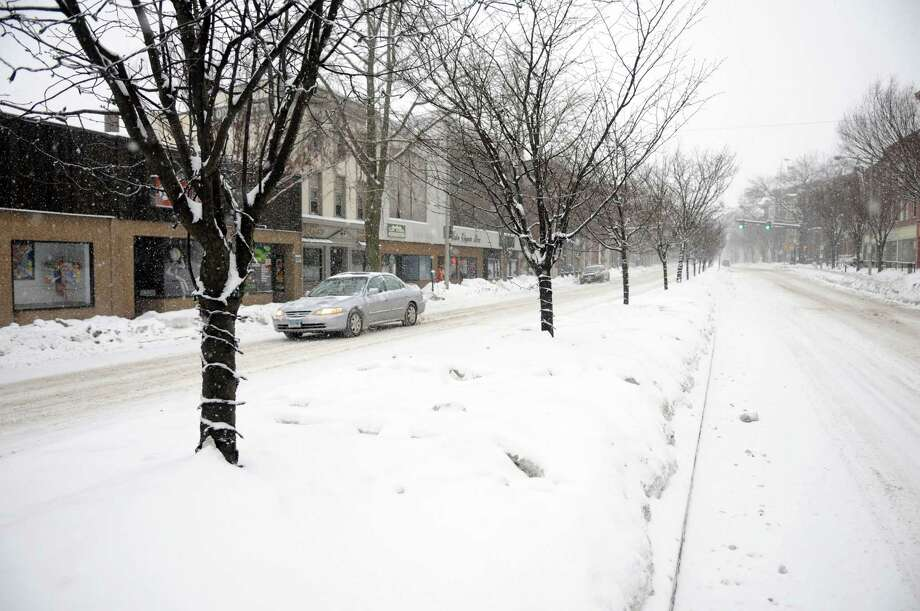 Main Street in Danbury, Conn. is all but deserted Thursday morning, Feb. 13, 2014, during the early part of a snow storm. Photo: Carol Kaliff / The News-Times