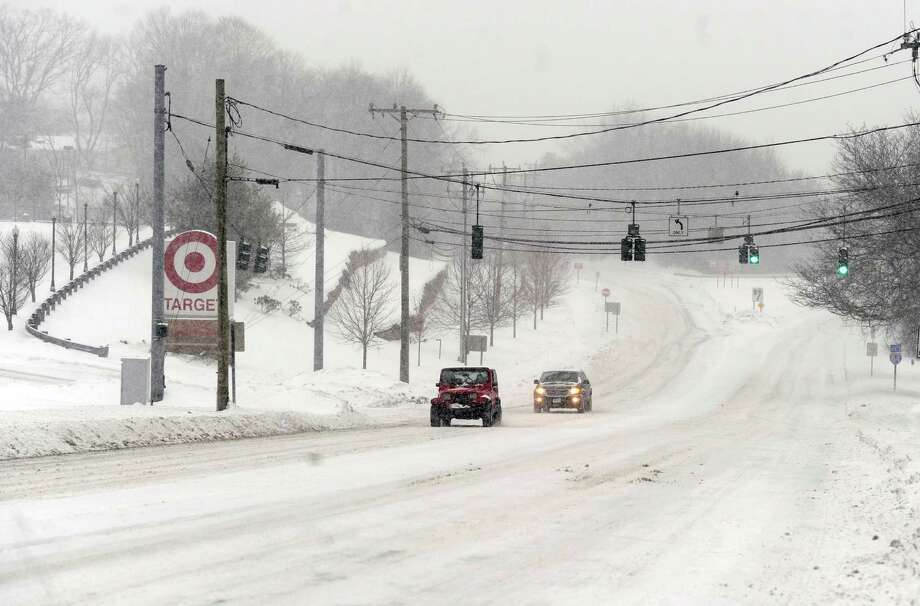 Traffic is light near Taget on Route 6 in Bethel, Conn., during the early stages of a snow storm, Thursday morning, Feb. 13, 2014. Photo: Carol Kaliff / The News-Times