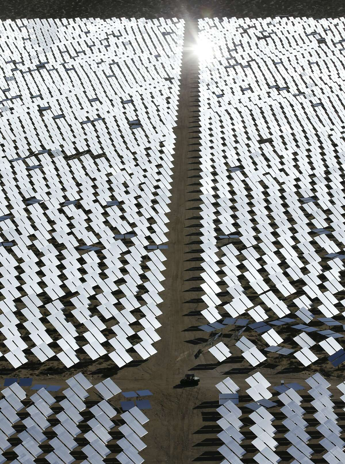 Some of the 300,000 computer-controlled mirrors, each about 7 feet high and 10 feet wide, reflect sunlight to boilers that sit on 459-foot towers. The sun's power is used to heat water in the boilers' tubes and make steam, which in turn drives turbines to create electricity Tuesday, Feb. 11, 2014 in Primm, Nev. The Ivanpah Solar Electric Generating System, sprawling across roughly 5 square miles of federal land near the California-Nevada border, will be opened formally Thursday after years of regulatory and legal tangles.