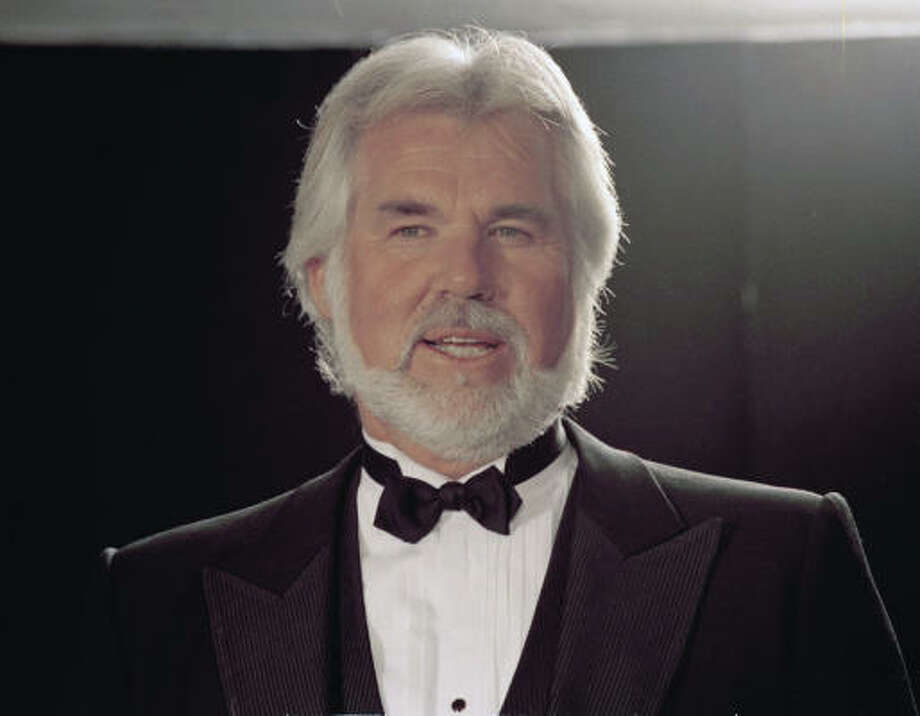Kenny Rogers has stated he would never have plastic surgery again. We tend to agree with him that he shouldn't. Here he is in 1989. Photo: Associated Press