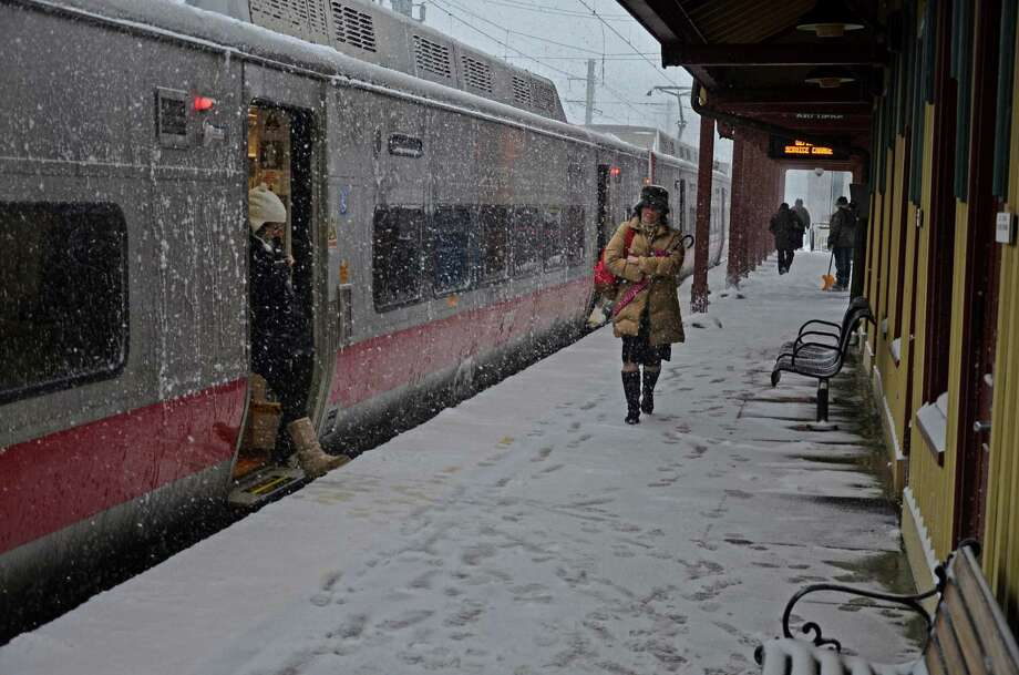 Commuters at the New Canaan train station Thursday morning, Feb. 13. Photo: Nelson Oliveira / New Canaan News