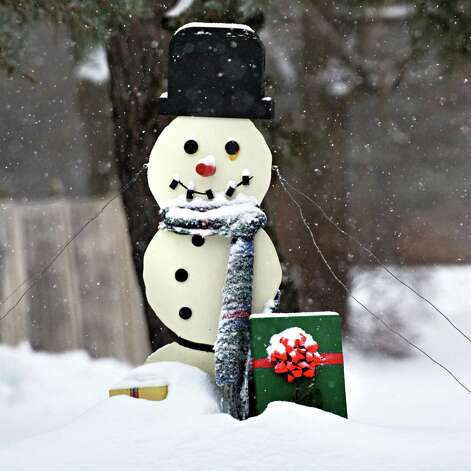 A left over Christmas decoration seems apropos as snow begins to fall Thursday morning Feb. 13, 2014, in Clifton Park, NY.   (John Carl D'Annibale / Times Union) Photo: John Carl D'Annibale / 00025747A