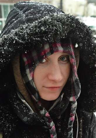 Bundled up and dusted with snow, Amber Gagnon of Cohoes makes her way to the post office Thursday Feb. 13, 2014, in Cohoes, NY.   (John Carl D'Annibale / Times Union) Photo: John Carl D'Annibale / 00025747A
