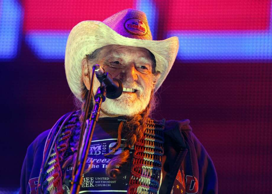 Country music legend Willie Nelson performing during the Farm Aid 2012 concert at Hersheypark Stadium in Hershey, Pa. Photo: Jacqueline Larma, Associated Press