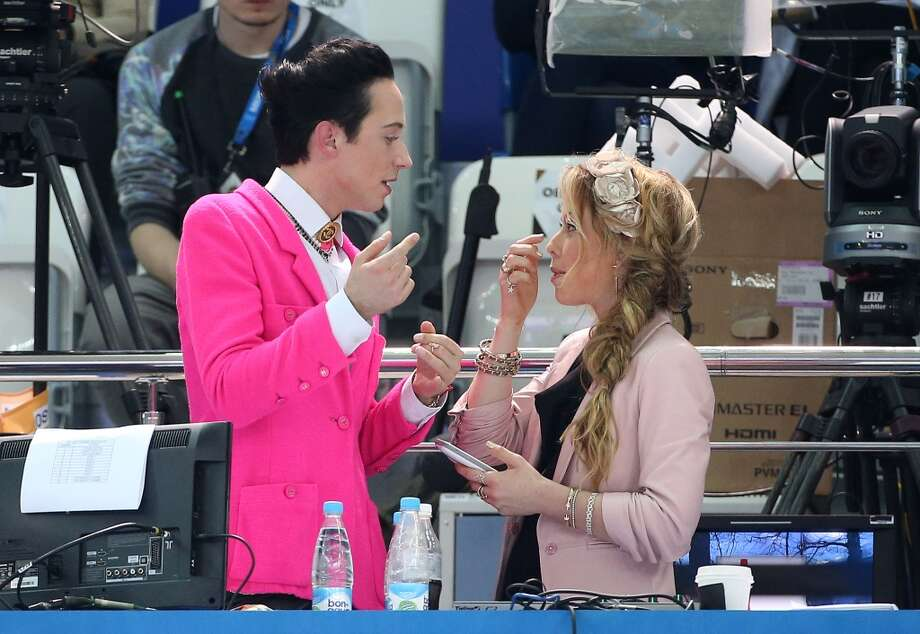 Figure skating champions Johnny Weir and Tara Lipinski comment for NBC on the Figure Skating Pairs Short Program on Day 4 of the Sochi 2014 Winter Olympics at Iceberg Skating Palace, Feb. 11, 2014, in Sochi, Russia. (Photo by John Berry/Getty Images) Photo: John Berry, Getty Images