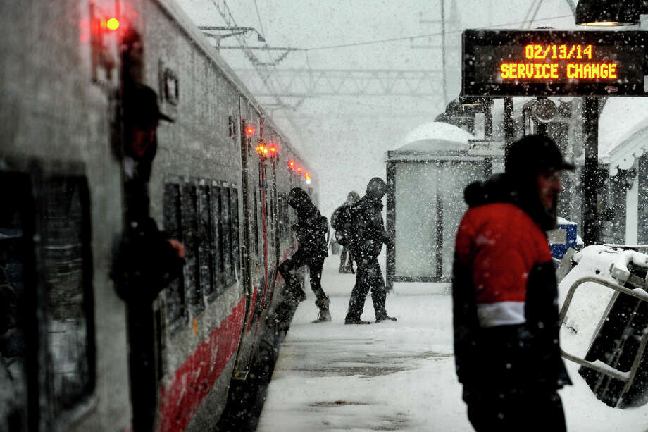 A Metro-North train arrives as heavy snow falls in Stratford, Conn. on Feb. 13, 2014. Photo: Ned Gerard / Connecticut Post