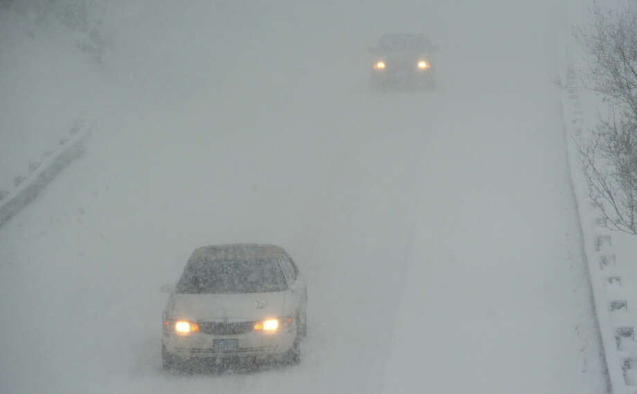 Heavy snow falls on the Merritt Parkway in Stratford, Conn. on Feb. 13, 2014. Photo: Ned Gerard / Connecticut Post
