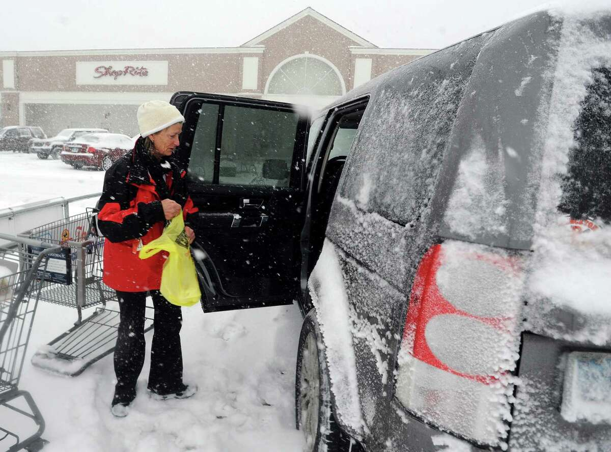 Mary Cunningham picks up some groceries at the ShopRite in Fairfield, Conn. about 930am on Thursday, Feb. 13, 2014. The store said thay would stay open as long as possible and will make the decision to close based on how busy they are.