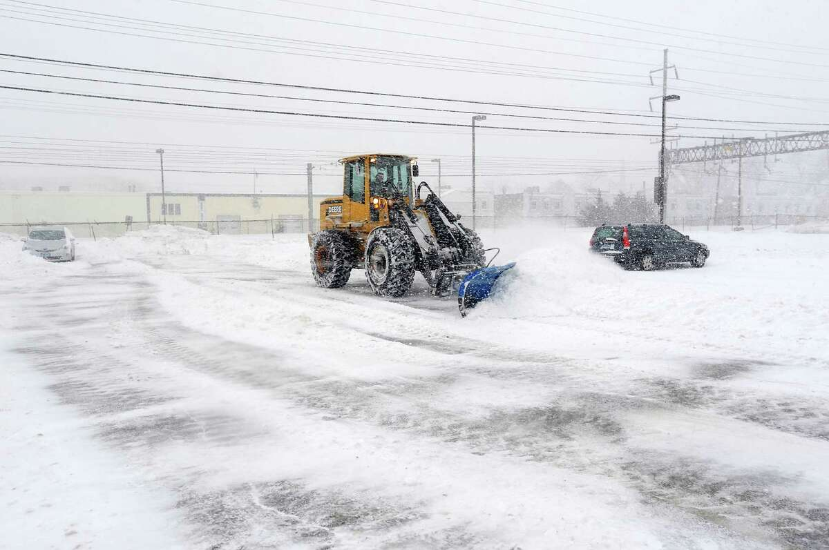 Continual clean-up of the downtown train station parking lot was underway in Fairfield, Conn. on Thursday, Feb. 13, 2014.