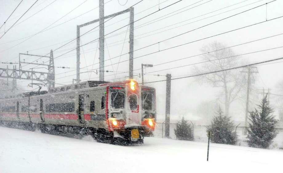 A southbound Metro-North train heads down the line about 1030am  in Fairfield, Conn. on Thursday, Feb. 13, 2014. Photo: Cathy Zuraw / Connecticut Post