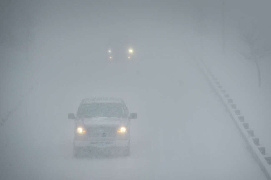 Heavy snow falls in Stratford, Conn. on Feb. 13, 2014. Photo: Ned Gerard / Connecticut Post